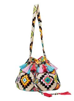 Girls aztec print drawstring bag with multi coloured tassels. Featuring internal pockets and adjustable strap. Bag can be worn over on the shoulder or across the body. Height 35cm, width 30cm, strap length 120cm. Cotton.