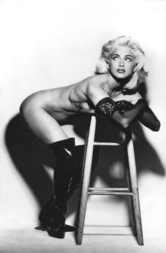 Madonna protecting her stool from robbers I bet.