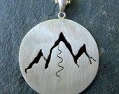 Our Mountain Pendant is in a treasury on Etsy! Spreading the love...