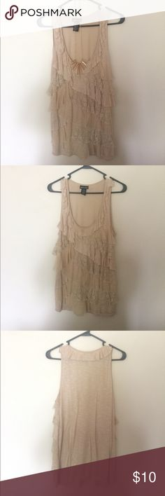 Ruffle tank top Cream-colored tank with front ruffles. Cute under a jacket or open cardigan. In great condition. Styled with gold statement necklace. Wet Seal Tops Tank Tops