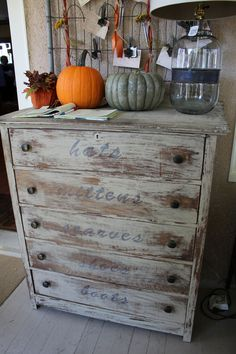 "A dresser re-done with stencils, ""hats"", ""mittens"", ""scarves"", ""shoes"", ""boots"", on the drawers to hold winter wear."