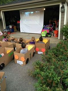 "DRIVE-IN MOVIE B-DAY PARTY: Kids decorate cardboard boxes as cars (with paper plates and cardstock) and then eat treats from the ""snack bar"" while they watch a movie. [Watching CARS obviously. ;) ]"