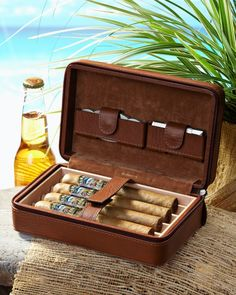 Tommy Bahama minus cigars. suitcase idea for a gift idea with corona and joe vs. dvd