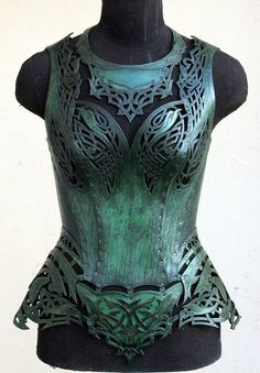 Where armor meets corset -- utterly exquisite leather corsetry, painted to look like metal.  Gorgeous!