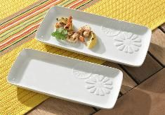 #664 :: MARISSA RECTANGULAR TRAY PAIR :: Crafted from porcelain with embossed details and a beautiful white glaze.  Long, narrow shape of the trays is ideal for serving kabobs, appetizers and more.  You can bake on the trays, too, because they're oven safe up to 400°F :: $44.95 :: Contact Me With Your Order::: lynnebeveridge@myprincesshouse.com