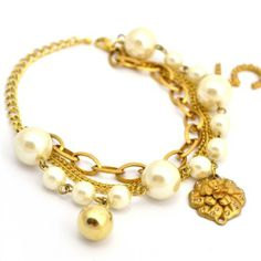 Flower Charm  Pearly Bead Bracelet FD To purchase just click on Amazon right here http://www.amazon.com/dp/B00D7ARTJA/ref=cm_sw_r_pi_dp_EX5Qtb0G7A25388V