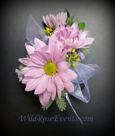 Simple lavender daisy pin on corsage.  #WildRoseEvents #weddingflowers #corsage