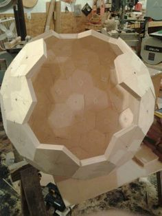 """A 26"""" diameter globe under construction. The polyhedron core is made from baltic birch plywood for stability, and it will be completely covered with a variety of hardwoods representing continents, countries, states, oceans and other features."""