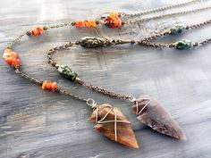 Jasper arrowhead pendants, with handmade beaded chains and wire wrapped arrowheads with tinned copper wire. Feminine with a touch of edge, lightweight and super easy to wear! Dimensions Orange/brass chain necklace: Neck length: 16 with 2 extension Hanging chain/pendant length: 9  Green/copper chain necklace: Neck length: 16 with 2 1/2 extension Hanging chain/pendant length: 8 1/2  All items come ready in a handmade muslin baggie which is perfect for gifting, or u...