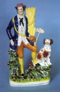 """""""The Woodcutter"""" Many fine figure groups depicting rural life often included """"man's best friend"""". This particular group appears in two sizes. Both are rare. Circa 1855, Height 14 inches"""
