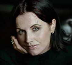 Dolores O'Riordan is an Irish singer, guitarist and songwriter. She led the rock band The Cranberries to worldwide success and fame for 13 years before the band took a hiatus in 2003, but have since reunited in 2009.