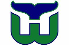 This simple-looking logo is actually quite clever. First, you have the whale's tail, the letter W in green, and an H in the white space.