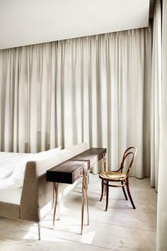 elegant solution for the bedroom with a curtain all round (in a number of panels); might even be used for hiding the closet...