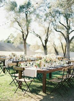 beautiful wood and iron chairs for outdoor wedding reception