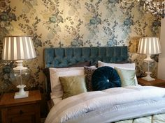 Taylor Wimpy - wychbold. Guest bedroom idea - Teal velvet headboard  with gold and teal metallic rose wallpaper and traditional wood side tables