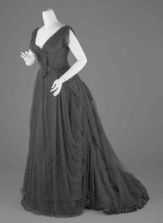 Bustle Evening Dress: although this dress has a more modern neckline, this style of dress was appropriate and stylish for evening events in the Bustle Period