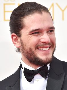 Jon Snow is pulling a Jared Leto! Game of Thrones actor Kit Harington went for a bold look when he swept his long, curly hair into a slicked-back man bun at the 2014 Emmys!
