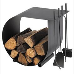 Dixneuf Caracol Log Holder with Firetools. Fire tools supplied are, poker, ash shovel and hearth brush. Contemporary Fireplace accessory set, designed and manufactured in France by Dixneuf. Wood Storage Rack, Firewood Storage, Contemporary Fireplace Accessories, Design Entrée, Log Carrier, Stove Accessories, Firewood Holder, Log Holder, Wood Burner