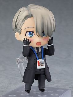 "Victor Nikiforov Coach ver Yuri!!! on ICE Nendoroid Figure ""I don't think I'd kiss anything other than a gold medal...""  From the popular anime series ""YURI!!! on ICE"" comes a Nendoroid of Victor Nikiforov wearing his coach outfit! He comes with two face plates including a crisp standard expression as well as a amazed expression for when he is watching Yuri's performance."