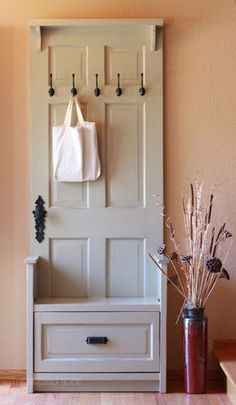Entry bench made from an old door (via Poppytalk: 8 Super-Fun Weekend Projects!)