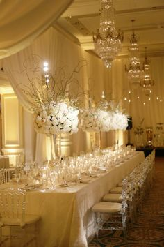 photo: Dominique Fierro; all white classic wedding reception centerpiece;