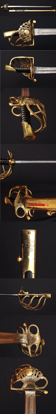 Officer of the Imperial Guard Grenadier Horse's sword.   In any case it did belong to an Heavy Cavalry Officer from Napoléon Army, dated from October 1811.
