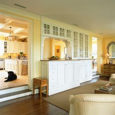 Kitchen with sunken Living Room...something about this I like....maybe the sunny glow
