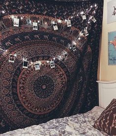 Picture/Polaroid display from a string of lights; mandala tapestry; bohemian style bedroom