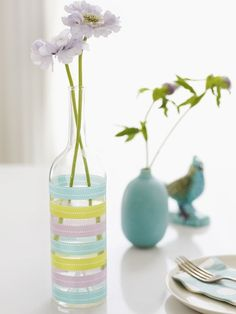 Decorate a bottle with washi tape to make a pretty, easy vase: | 22 DIY Ways To Reuse Empty Booze Bottles