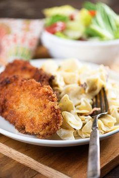 These pan-fried pork chops are served alongside egg noodles with a simple cream cheese sauce. Perfect for a quick weeknight dinner! Someone please tell me that I'm not the only one who gets sudden intense Cheese Noodles, Egg Noodles, Pork Chop Recipes, Chicken Recipes, Meat Recipes, Pasta Recipes, Recipies, Easy Meal Plans, Easy Meals