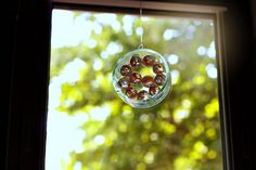 Glass bottle ring and marbles sun catcher