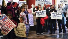 Protestors filled the Capitol rotunda in Helena, Mont., during a February rally to show support in an attempt to change the Montana Constitution to define life as beginning at conception. The so-called personhood initiative is intended to prompt a legal challenge to Roe v. Wade, the 1973 Supreme Court decision that established a legal right to abortion. (AP Photo)