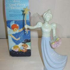 """Avon """"Good Fairy"""" Figurine Cologne Bottle Filled With Daisies Cologne"""
