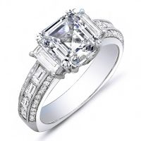 This captivating 2.21 Ct. diamond engagement ring will certainly make her eyes glow with delight. At the center is an eye-catching GIA certified 1.01 Ct. Asscher cut diamond with VVS2 clarity and G color grade. On each side of the center stone are Baguette cut diamonds while additional Baguette and Round cut diamonds line the shank in channel and micro pave set, respectively. These 1.20 Ct. side diamonds have F-G color grade and VVS1-VVS2 clarity to match the center diamond. This diamond…