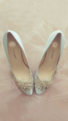 - Like no other - Dawn - 3-dimensional hand-made glass crystal embellishment - Vine-like beading across toe vamp and side of shoe - Walk down the aisle in this exquisite beauty - Light blue with silve