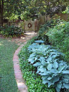 Love the brick border and garden gate!