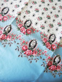 Vintage feedsack fabric.  Aqua blue with pink roses and black silhouette cameo ladies.