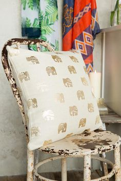 Refresh your home or apartment with the beautiful Gold Elephant Pillow! Bright metallic elephants give this pillow a glittering pop of color