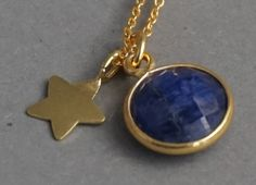 Sapphire and gold star pendant necklace. Natural sapphire. Gold vermeil star. Layering. Stacking. $48.53   www.belovedblossom.etsy.com