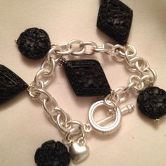 Bracelet Genuine carved black diamond and round shaped cinnabar, silver plate heart, silver plate chain, toggle clasp. Jewelry Bracelets