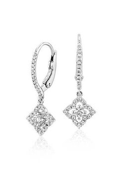 These petite diamond floral drop earrings flaunt vintage-inspired details with an innate feminine flair.