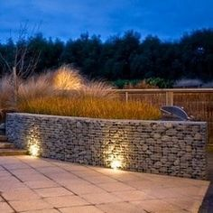 LOW COST Stone gabion baskets night lighting and design ideas for retaining walls Garden landscaping rock wall fencing materials Gabions for waterfalls ponds fences Landscape gardens Gabion Stone, Gabion Retaining Wall, Retaining Wall Design, Low Retaining Wall Ideas, Concrete Stone, Fence Landscaping, Landscaping With Rocks, Retaining Wall Construction, This Old House