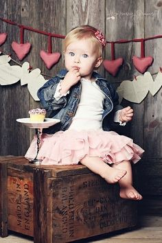 Pretty birthday photo  for Ella's 2nd b day. heart background, cute outfit, and cupcake on a stand