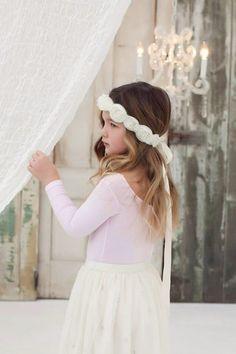 A personal favorite from my Etsy shop https://www.etsy.com/listing/106231544/silk-organza-headband-rosettes-wedding