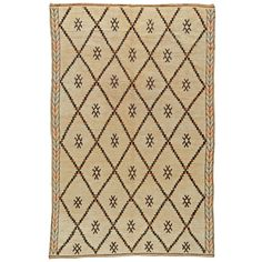 Vintage Moroccan Rug   From a unique collection of antique and modern moroccan and north african rugs at https://www.1stdibs.com/furniture/rugs-carpets/moroccan-rugs/