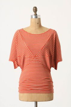 Would love this in a solid color! I have more than enough striped tops in my closet.