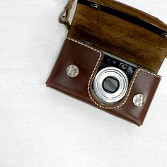 little leather digicam case. I don't know what camera or where I would get this but I love it!