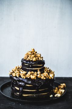 Double Chocolate-Peanut Butter Layer Cake with Caramel Popcorn. #cakes #desserts #popcorn