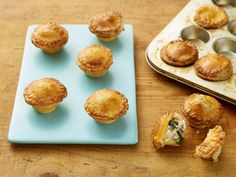Mini Chicken and Broccoli Pot Pies from FoodNetwork.com. Great for leftover turkey and broccoli- I thinned out the crust for the bottom and pre-baked them, in regular size muffin cups, doubled the filling recipe, topped with pastry, egg wash and Parmesan, deeeelicious...