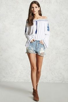 Pair with denim shorts and a wide brim hat.